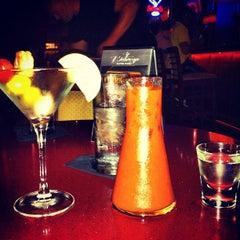 Photo taken at Bistango Martini Lounge by Nick H. on 7/8/2012