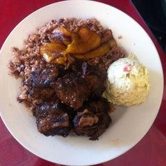 Photo taken at Joan And Sisters Belizean Restaurant by Brett N. on 10/7/2012
