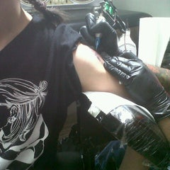 Photo taken at Wild Ones Tattoo by Than L. on 5/6/2013