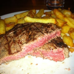 Photo taken at Hawksmoor Seven Dials by Meri W. on 3/13/2013