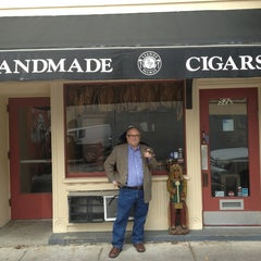 Photo taken at Lianos Dos Palmas Cigars by Phil Y. on 2/27/2013