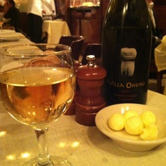 Photo taken at Harry Cipriani by Olivia B. on 12/30/2012