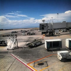 Photo taken at Frontier Airlines (Gates 24 - 32) by Matt M. on 9/8/2013