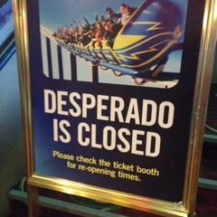 Photo taken at The Desperado Roller Coaster by Andy W. on 4/19/2014