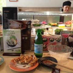 Photo taken at Sushi Train by Gavin W. on 10/17/2012