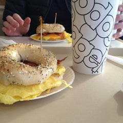 Photo taken at Bodo's Bagels by rebecca o. on 12/23/2012