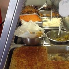 Photo taken at Singh's Fast Food by Ingrid N. on 12/21/2013