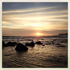 Photo taken at Coronado Beach by Lulu on 1/6/2013