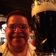 Photo taken at Tigín Irish Pub and Restaurant by Bob T. on 5/24/2015