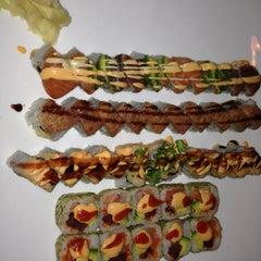 Photo taken at Izumi Japanese Steak House & Sushi Bar by Amber G. on 5/11/2013
