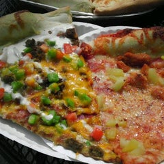 Photo taken at Ian's Pizza by the Slice by Kenny L. on 7/7/2012