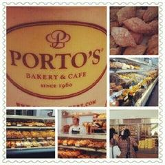 Photo taken at Porto's Bakery & Cafe by Melanie D. on 7/24/2012