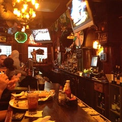Photo taken at Green Door Tavern by Jessica M. on 3/15/2012