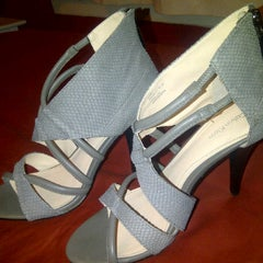 Photo taken at DSW Designer Shoe Warehouse by Chachy S. on 2/23/2012