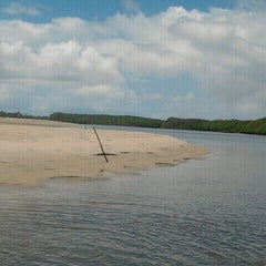 Photo taken at Praia Da Costa by Nathany N. on 2/23/2012