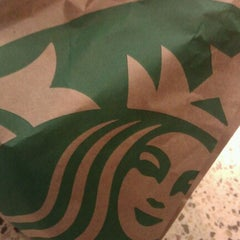 Photo taken at Starbucks by Rebecca on 4/23/2012