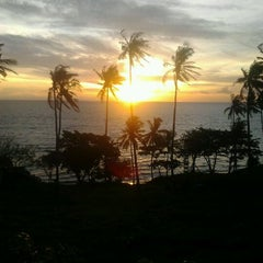 Photo taken at Pantai Senggigi by Den B. on 12/8/2011