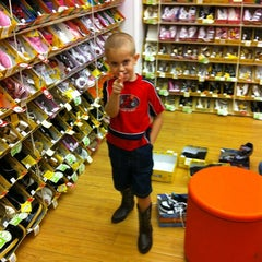 Photo taken at Payless ShoeSource by Melissa L. on 8/1/2012