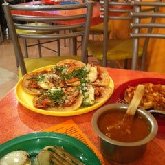 Photo taken at Tacos Latosos by Miguel M. on 10/8/2011