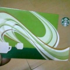 Photo taken at Starbucks (สตาร์บัคส์) by Sorasak I. on 12/24/2011