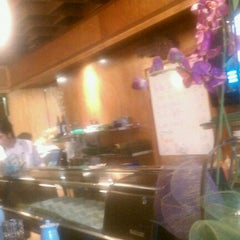 Photo taken at Sushi Raw by Angelo O. on 1/11/2011