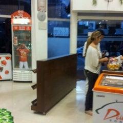 Photo taken at Além do Pão Delicatessen by Gilson P. on 10/16/2011