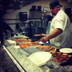 Photo taken at Secret Pizza by John N. on 10/23/2011
