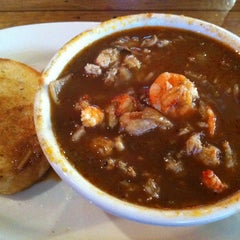 Photo taken at Boudreaux's Cajun Kitchen by Pong on 6/2/2012