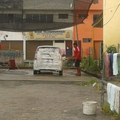 Photo taken at Mobil Stations Carwash by Wan V. on 3/10/2012
