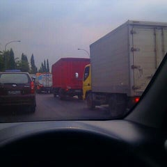 Photo taken at Exit tol curug / bitung by Yogi A. on 11/15/2011