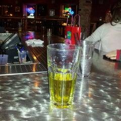 Photo taken at Throwbacks Grille & Bar by Adam J. on 2/24/2012