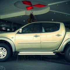 Photo taken at Motorysa Mitsubishi Colombia by Alejandro B. on 12/27/2011
