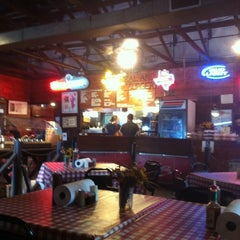 Photo taken at Iron Works BBQ by Emma S. on 3/16/2012