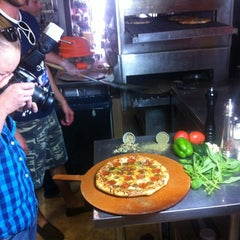 Photo taken at Denver Pizza Company by Zach K. on 4/12/2012