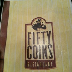 Photo taken at Fifty Coins by Alli S. on 12/29/2011