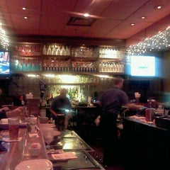 Photo taken at Outback Steakhouse by Meg B. on 11/26/2011