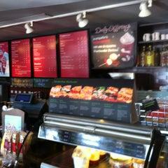 Photo taken at Starbucks by Liza C. on 11/16/2011