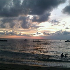 Photo taken at Pantai Senggigi by Amiko R. on 12/13/2011