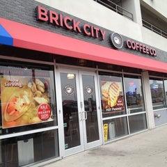 Photo taken at Brick City Coffee Co by Carolina E. on 5/3/2012