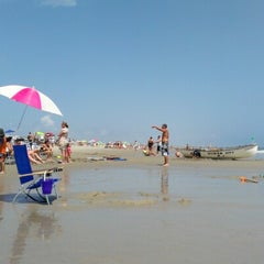 Photo taken at 44th street beach by Draco J. on 8/4/2012