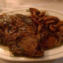 Photo taken at La Siesta Restaurant Bar by Emmanuel L. on 8/1/2012