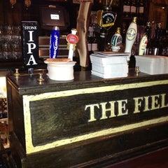 Photo taken at The Field Irish Pub & Restaurant by Keven B. on 7/31/2012