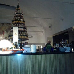 Photo taken at Milano Lounge Cafè by Laura C. on 1/5/2012
