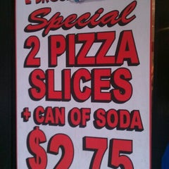 Photo taken at 2 Bros Pizza by James H. on 12/15/2011