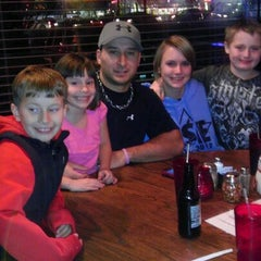 Photo taken at Gino's East by Robin M. on 12/8/2011