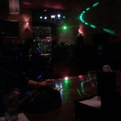 Photo taken at Babaloo International Cafe and Bar by Kristina M. on 3/11/2012