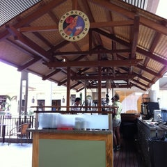 Photo taken at Honolulu Coffee Company by Blanche L. on 4/5/2011