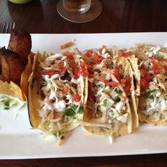 Photo taken at Tommy Bahama Store & Restaurant by Jen J. on 6/15/2012
