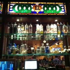 Photo taken at Emerald Loop Bar and Grill by Corey T. on 4/5/2012