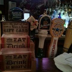 Photo taken at The Lion & Rose British Restaurant & Pub by Glenn J. on 12/17/2011